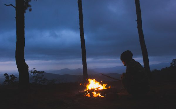 A night on the wreckage of a roaring fire between the mountain forest.