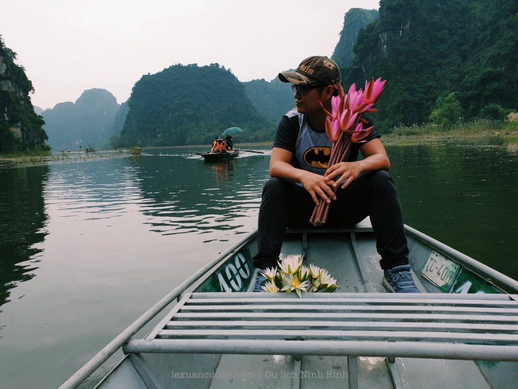 Sit boat along Tam CoC River, pass through 3 different caves.