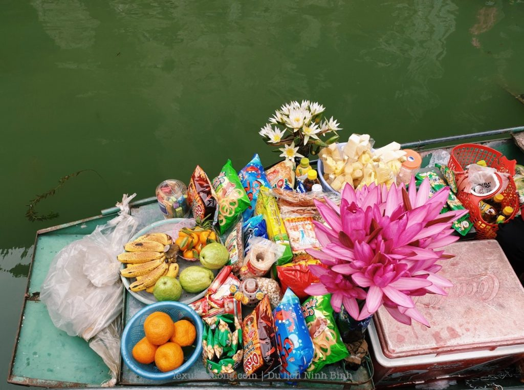 Grocery on the river with a wide variety of cakes to sell for visitors.